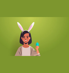 woman wearing bunny ears cute girl holding egg vector image