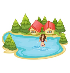 A girl with a purple bikini swimming at the beach vector image vector image
