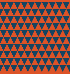 dark blue and orange triangles seamless pattern vector image