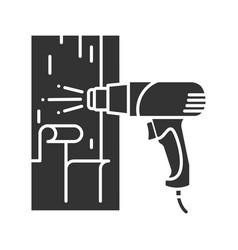 Hot air gun heating surface glyph icon vector