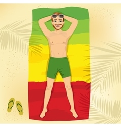 Young man lying on a towel at the beach vector