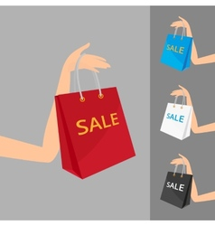 Red shopping bag in womens hand and three vector