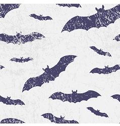 Seamless halloween grunge pattern with bats vector