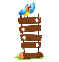 A parrot at the top of the signboards with arrows vector image vector image