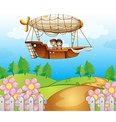 An airship passing hills with kids vector