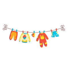 various items baby clothes on rope isolated vector image
