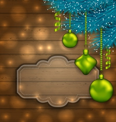 New Year label with balls and fir twigs on wooden vector image vector image
