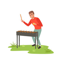 Smiling man cooking barbecue outdoor vector