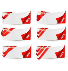 Red sale banners with red ribbons vector image