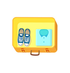 Shoes and shirt on luggage vector