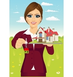 Female real estate agent holding the key vector