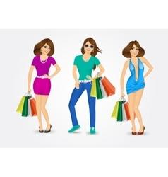 Women carrying shopping bags vector