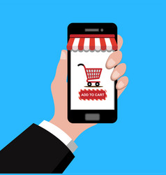 hand holding smartphone with shopping cart vector image vector image