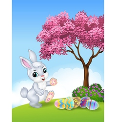 Cute Easter bunny walking with colourful Easter eg vector image