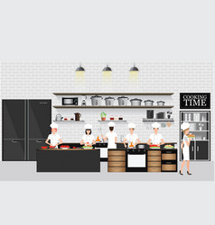 Chefs cooking at the table in restaurant kitchen vector
