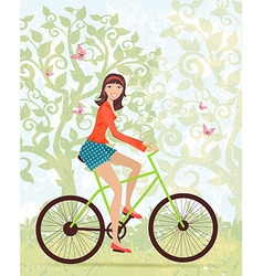 Happy girl on a bike outdoors in spring vector image