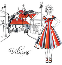 fashionable girl in old town of vilnius lithuania vector image vector image