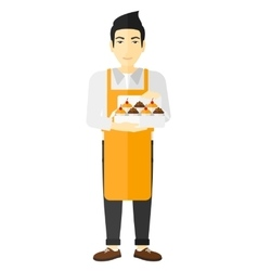 Baker holding box of cakes vector