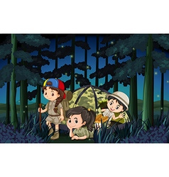 Girls camping out in the forest at night vector