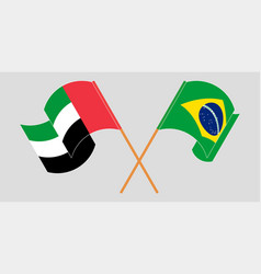 Crossed and waving flags brazil and united vector