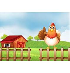 A chicken above a wooden fence at the farm vector