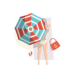 Young woman sunbathing on the beach under umbrella vector