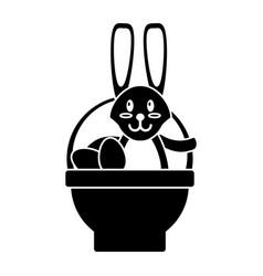easter rabbit inside egg basket pictogram vector image