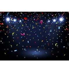 Colorful confetti on black background with spotlig vector