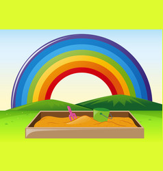 Park scene with sandpit and rainbow vector