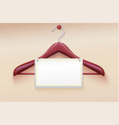 Wooden hanger with tag isolated on cream vector