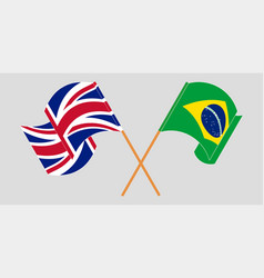 Crossed and waving flags brazil and uk vector