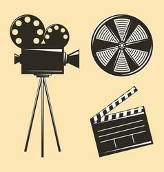 vintage camera tripod and film strip clapperboard vector image