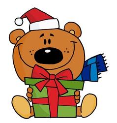 christmas bear holding a present vector image
