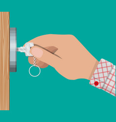 Key in hand opens wooden door vector
