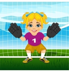Young female goalkeeper in a ready position vector