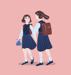 Pair of girls dressed in school uniform walking vector
