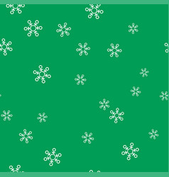 white snowflakes on a green background seamless vector image