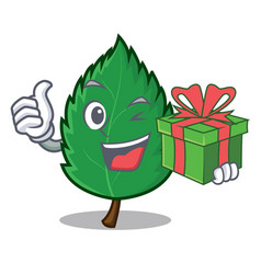 With gift mint leaves mascot cartoon vector