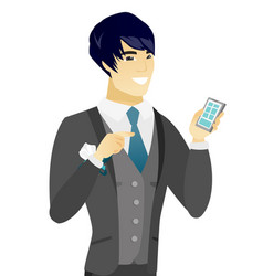 Young asian groom holding a mobile phone vector