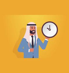Arab man holding clock time management deadline vector
