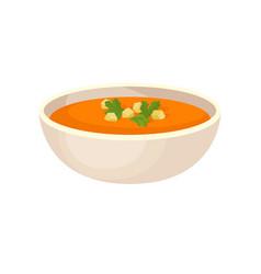 Pumpkin cream soup with cream in a bowl vector