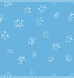 white snowflakes on a light blue background vector image