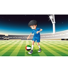 A boy kicking the ball with the United Arab vector