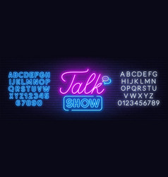 Talk show neon sign on brick wall background vector