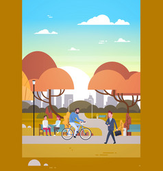 people relaxing in beautiful autumn urban park vector image