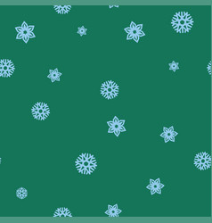 blue snowflakes on a green background seamless vector image