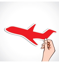 red airplane sticker in hand vector image