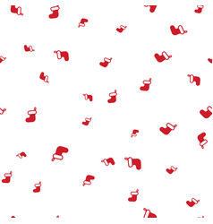 red christmas boot on a white background seamless vector image