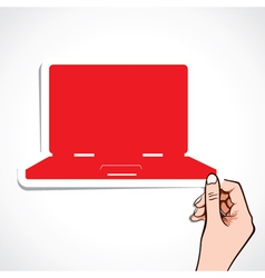 red laptop sticker in hand vector image