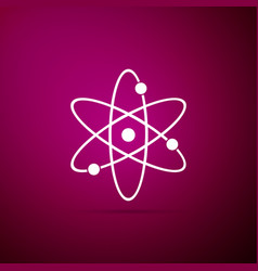 atom icon isolated on purple background vector image